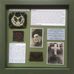 Framed display of the personal effects of Private Alan Heaton Hodgson