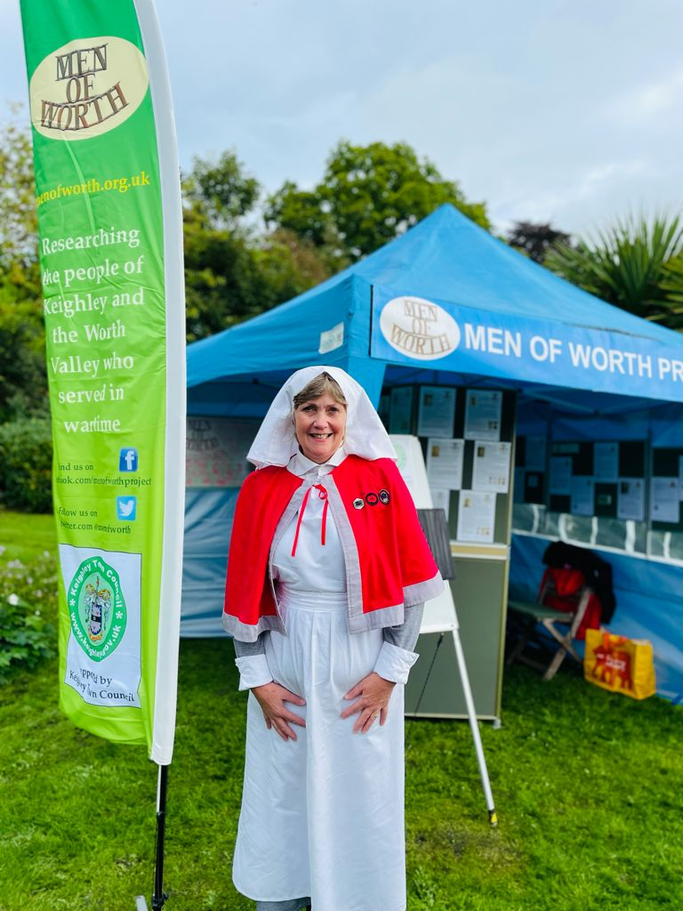A lady dressed as a trained nurse visits our stand
